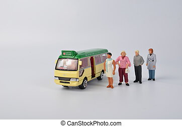 Miniature travellers at a busy bus station - the Miniature...