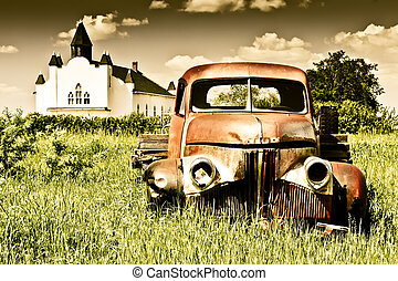 Old Red Farm Truck - Old rusty red farm truck fading in...
