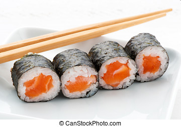 Four Hosomaki salmon sushi wound in rice and sea weed served...