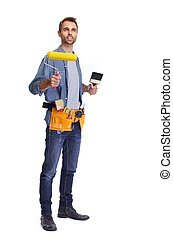 Handyman. - Handsome handyman with painting roller. House...