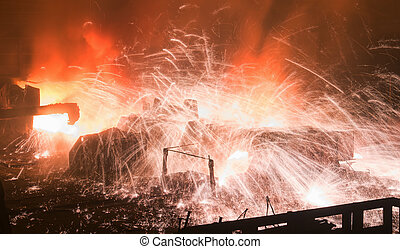 opening of the blast furnace - Sparks during opening of the...