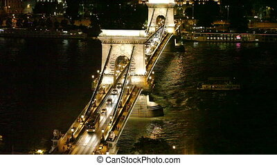 Szechenyi Bridge through Danube in Budapest - Night traffic...