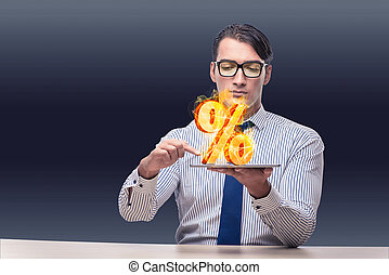 Businessman with percent sign in high interest concept
