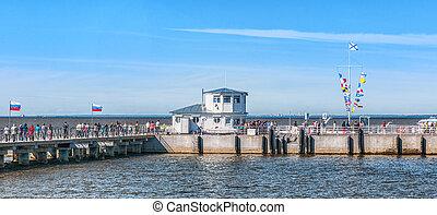 Meteor speedboat awaiting for departure in Harbor. PETERHOF,...