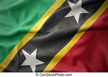 waving colorful flag of saint kitts and nevis.