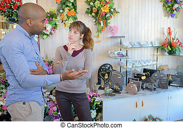two people talking at a funeral-home
