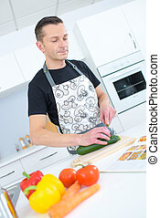 middle-age man cooking at home