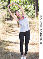 fit woman streching in part after run