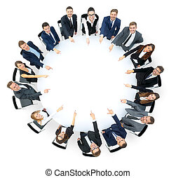 Happy business team pointing at something - Diverse group pf...
