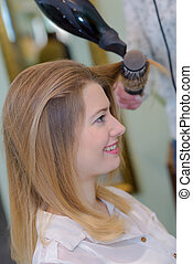 blond woman at the hairdresser