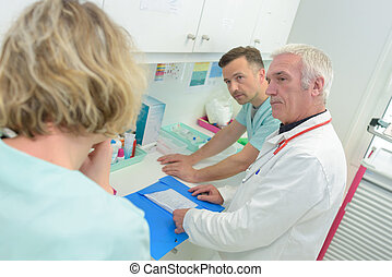 doctor discussing results with nurse team