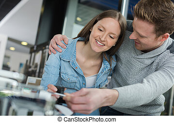 young couple fixing a devise at home