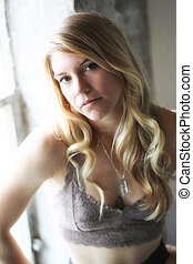 Portrait of a Beautiful Blond Woman with Brown Eyes - Photo...