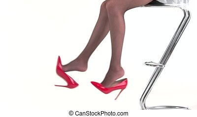 Legs and red heels. Woman sits on bar chair. Look stylish...