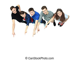 group of young people pointing at something