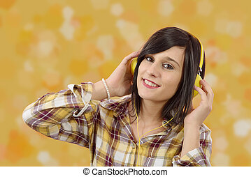 young brunette listening to music with headphones
