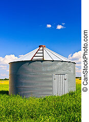 Grain Silo - Metal grain silo used to store grain and other...