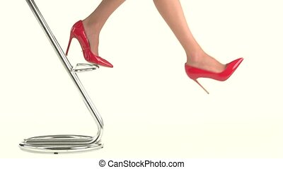 Woman's legs in glossy heels. Bright shoes on high heel....