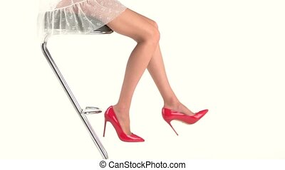 Legs in bright heels. Red female shoes. Sexy and trendy....