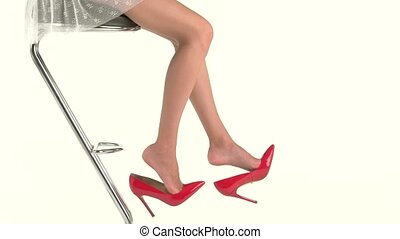 Woman's legs and red shoes.