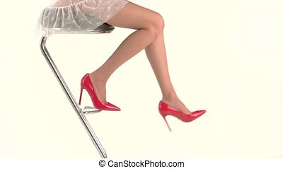 Legs in high heels. Woman and bar chair. Fashionable and...