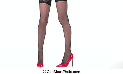 Woman's legs with shoes isolated. Red heels with fishnets....