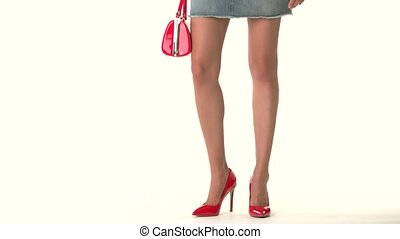 Legs in heels and purse. Short denim skirt. Youth and...