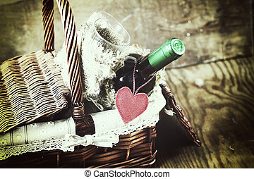 basket with wine love heart shape