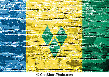 Saint Vincent and the Grenadines flag on old wood texture