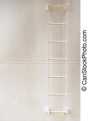 Abstract image with rungs of painted shipboard ladder on...