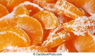 Peeled rotating mandarin segment, close up, as background...