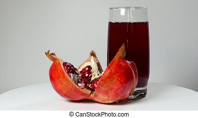 Pomegranate juice in a glass and ripe pomegranate (seamless...