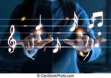 Woman hands playing music notes on dark background, music...