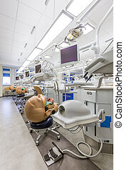 Classroom with technological facilities and manikins -...