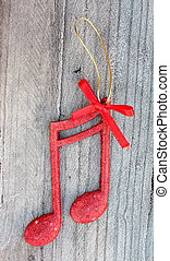 red shiny decorative christmas music notes - picture of a...