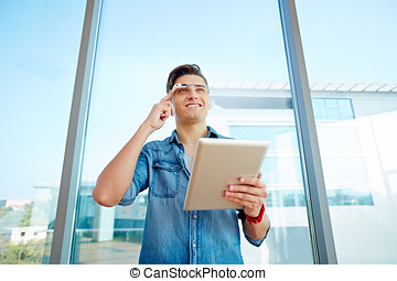 man in google glasses in office at window