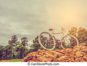 bicycle on the top of rock mountain