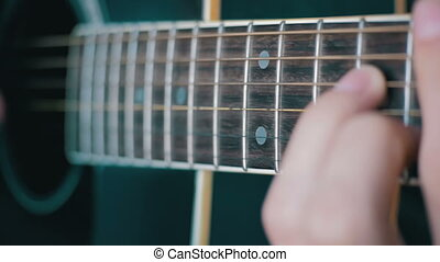 Man Playing Acoustic Guitar. Playing on acoustic guitar with...