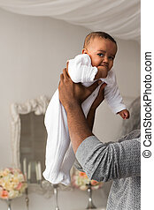 African American Father Holding Baby
