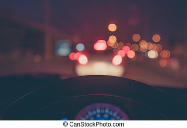 blur image of people driving car on night time. - vintage...