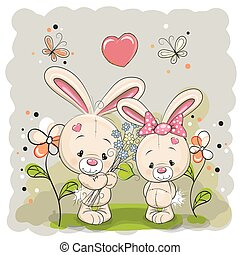 Rabbit boy and girl with flowers on the meadow