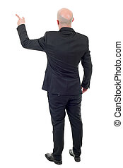 pointing - young businessman full body, pointing, in a white...