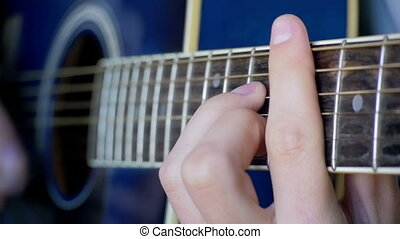 Man Playing Acoustic Guitar. Slow Motion in 96 fps. Playing...