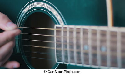 Man Playing Acoustic Guitar. Slow Motion