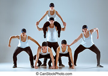 Group of men and women dancing hip hop choreography - Group...
