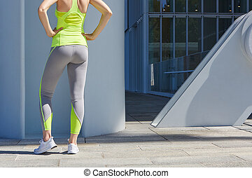 Woman body before sport in the city sunlight - Woman body...