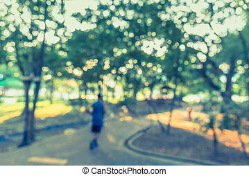 Blur image of people activities in park . - Blur image of...