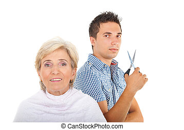 Hairstylist man holding scissors and preparing to cutting...