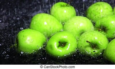 Green apples being washed super slow motion dolly shot
