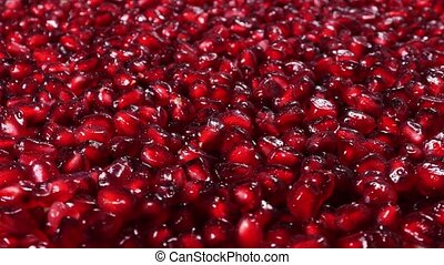 Rotating fresh pomegranate seeds for food background...